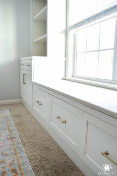 White office built-ins around a center window with gold hardware pulls Window Seat Cushions, Window Benches, Cheap Furniture, Furniture Design, Plywood Furniture, White Built Ins, Office Built Ins, Home Interior Design, Hardware Pulls