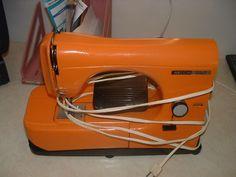 Cool orange sewing machine