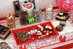 Valentine's Day chocolate covered oreos marshmallow pops fruit caramel popcorn pretzels on a plate