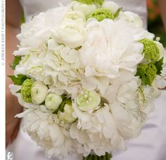 Hints of green from the lady's mantle and ranunculus added pops of color to Jennie's white bouquet of peonies, hydrangeas and lilies of the valley.