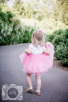 Little girl picking up her pink tutu at this family session at Baxter Gardens in Fountain City by Knoxville Wedding Photographer, Amanda May Photos