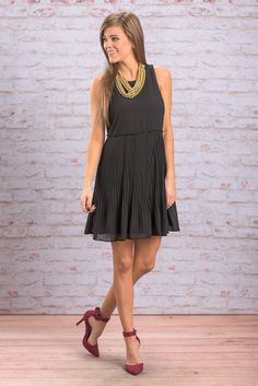 """""""Sleeveless Sheer Party Dress - Black"""" This dress is perfect for celebrating the holidays! The pleated skirt gives this dress so much movement and flare! The cut is wonderfully classic and chic!  #newarrivals #shopthemint"""