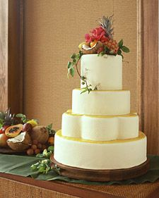 Tropical Wedding Cake - Martha Stewart. The yellow-cake layers are brushed with rum syrup and filled with passion-fruit curd and rum-and-vanilla-bean buttercream. The top of each tier is spread with more passion-fruit curd. Hibiscus flowers, lychees, coconut,  crown the cake. Pressing a straw mat into the fondant produces textured appearance. Serve with a slice of fruit such as star fruit, and coconut sorbet.
