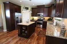 Acacia floor with dark brown cabinets. Acacia Floors Design Ideas, Pictures, Remodel and Decor Acacia Hardwood Flooring, Hardwood Floors In Kitchen, Best Flooring, Kitchen Flooring, Flooring Ideas, Wooden Flooring, Kitchen Decor, Kitchen Ideas, Kitchen Mats