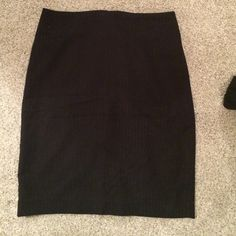 "Banana republic striped pencil skirt A classy pencil skirt black with pin stripes. ""Invisible"" zipper in the back with hook and eye, and a back slit. The skirt is made of soft but durable material with a built in slip. Worn once. Banana Republic Skirts Pencil"