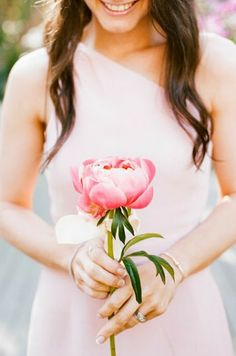 Instead of having your bridesmaids carry a full boutique of flowers, use a large single stem bloom. Simple but makes a nice statement.