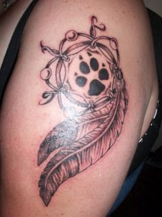 Leather Dream Catcher n' Wolf paw | Inked Magazine