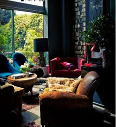 Various Dashing Dark Themed Interior For Living Room Design : Stylish Dark Living Room Designs Brown Leather Armchair Red Sofa And Blue Wood Coffee Table Bookcase Lamp Table And Fug Rug