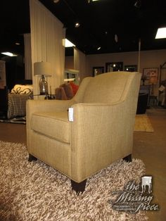 """The View club chair in a neutral tan. This chair is an ideal accent piece. You could place this in any room of your home! Sits quite nicely as well. Measures 29""""wide x 38""""deep x 35""""high. Currently, two in store. Arrived: Tuesday November 15th, 2016"""