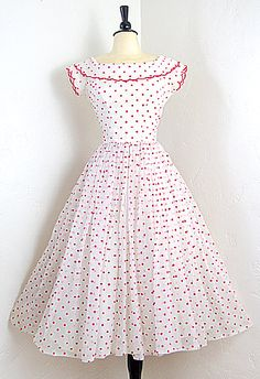 Amazing vintage 1950s Emma Domb vintage couture party dress in white with red swiss polka dots all throughout. Features scalloped detail on neckline and sleeves. Full skirt with sheer overlay. We added a small crinoline underneath, but this dress can really be much fuller!