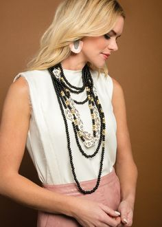 One of our favorite looks - the classic rope necklace - is made new in modern black and white beads composed of horn, bone and metal from India.