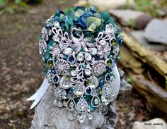 Vintage inspired teal and blue peacock brooch bouquet