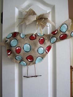 http://www.etsy.com/listing/78637144/burlap-bird-door-hanger-aqua-and-red