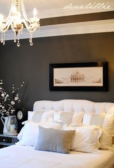 Charcoal walls with white bedding and accents= cozy
