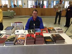 Author David Conley Nelson with his Moroni and the Swastika: Mormons in Nazi Germany front and center on the Benchmark Books table at the Sunstone Salt Lake City regional symposium on March Book Table, Mormons, University Of Oklahoma, Mind Over Matter, Salt Lake City, Book Publishing, Regional, Writer, Germany
