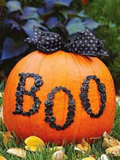 Cute no-carve pumpkin design! Paint the stem, tie a bow on top with pretty ribbon, and glue buttons to make letters or whatever shapes you want. (Hot glue gun is  best)