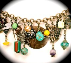 Charm bracelet details - turquoise, vintage, trade beads, antique buttons...