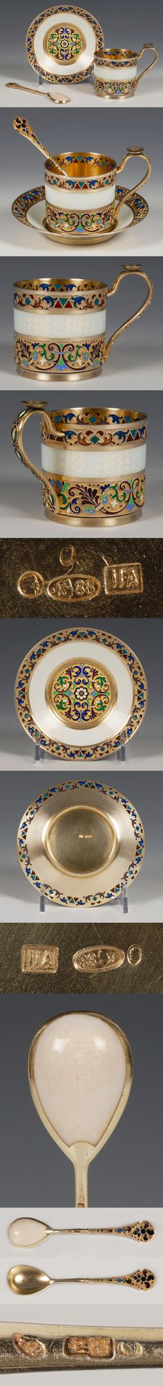 A Russian silver gilt, cloisonne and plique-a-jour enamel demi-tasse cup, saucer and spoon, 11 Artel, Moscow, circa 1908-1917. The cup, saucer and spoon decorated similarly with scrolling floral and foliate motifs in polychrome enamels, a similar plique-a-jour enamel band around the rim, the center with a band of translucent white enamel over engine turned ground.