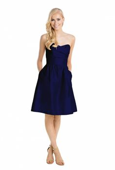 The Kristyn by Lulakate is a knee-length strapless bridesmaid dress with pleated sweetheart neckline, available in crystal, pearl, metal, and navy. | Rent on vowtobechic.com