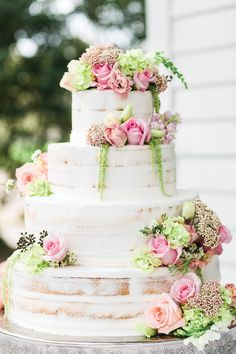 """Naked"" cake with fresh spring flowers. #wedding #cake"