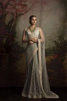 This saree featured in pastel green color net fabric. The border of the saree is handcrafted in zardozi work and skirt is in sequin and thread work. The blouse is in pastel green color dupion silk. This saree can be customized in any color of your choice. Lehenga Sari, Sabyasachi Sarees, Anarkali, Net Saree, Indian Dresses, Indian Outfits, Indische Sarees, Party Kleidung, Indian Look