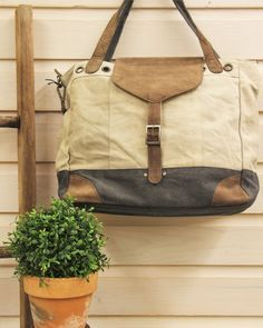 ReBlessed | Poplar Bluff, MO Mona B recycled canvas and leather handbags, purses, totes, messenger bags, crossbodies, wallets, and cosmetic bags.