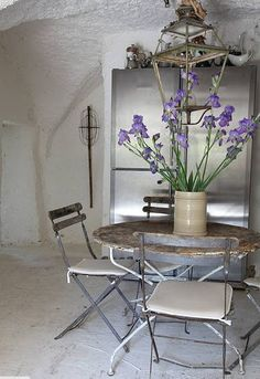 Décor de Provence - store chairs and use table as side table.