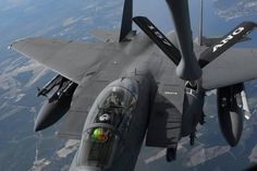 Pilots in an F 15E Strike Eagle receive fuel from a New Hampshire Air National Guard 3/17/2015 over North Carolina. Pilots are from Seymour Johnson AFB, NC