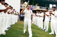 Sachin Tendulkar walks through a guard of honour on the first day of the Ranji match between Haryana and Mumbai