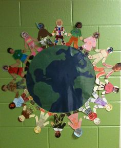 "Every year at Meet Your Teacher night, I give each student a blank ""paper person"" to take home as their first homework assignment. The kids decorate it to look like them and put their picture on the face. Once I have collected them all, I hot glue the Earth and the people in the hallway right next to my door and leave it up all year. I made the Earth a few years ago out of bulletin board paper and then laminated it."