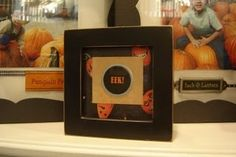 picture frame with scrapbooking paper and scrapbooking accents to make easy fall decor and thrifty too!