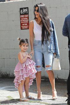 Kourtney Kardashian wearing Yeezy Season 2 Lucite Heel Sandals, Hermes Birkin Bag and Good American Ripped Bermuda Shorts