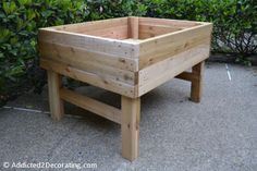Raised plant bed, this one would be better for my back and the dogs wouldn't be able to run through it. Must try this one !!!!