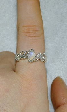 Sterling silver wire ring with a fabulous moonstone stone! This specific ring is in UK size K. You dont know your ring size? No problem! Click on the link to convert your size ring to UK standards. http://findmyringsize.com/en/conversiontable.aspx Rings may vary a little due to their handmade nature. You will receive your ring in a lovely ivory magnetic box to secure your jewels safety.If you have any question dont hesitate to ask me #wireringshandmade