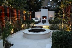 This garden was built by Landscaping Solutions Ltd and features London Stone's Beige Sawn Sandstone paving.  The garden won a BALI Principal Award.