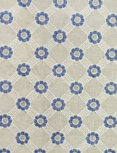 Rosetta Embroidered Linen Fabric Natural linen fabric with embroidered floral trellis in white and blue.