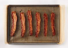 oven-crisped bacon:  Arrange strips of bacon on a rack set in a rimmed baking sheet. Roast the bacon gently and evenly in the oven at 375 degrees, rotating pan halfway through cooking, for about 15 minutes. This will ensure that there are no chewy pockets or overly-burnt bits.