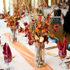 lots of twigs in this autumn centerpiece (fall, yellow, red, orange)    www.BrassTacksEvents.com