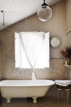 This looks wildly impractical - puddles on floor behind tub? Soaked shutters and window curtain? - but romance doesn't have to adhere sternly to practicality. Especially in a picture.