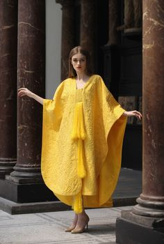 Gown of Gold Spun by a Million Spiders 4 years to make
