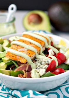 """""""As the weather gets warmer, light and healthy dinners seem even more appealing. This shortcut Salmon Cobb Salad with Light Avocado Dressing is an easy high-protein meal with layers of flavorful, nutritious ingredients! Deli Salad Recipe, Fruit Salad Recipes, Avocado Recipes, Salmon Recipes, Easy High Protein Meals, High Protein Recipes, Quick Easy Meals, Healthy Recipes, Avocado Dressing"""