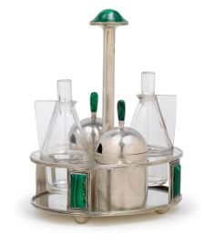 ** Josef Hoffmann, A four-part cruet stand,  designed in 1909, executed by the Wiener Werkstätte, silver, malachite, colourless glass