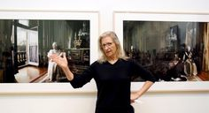 Annie Leibovitz in front of her portraits of Queen Elizabeth II.