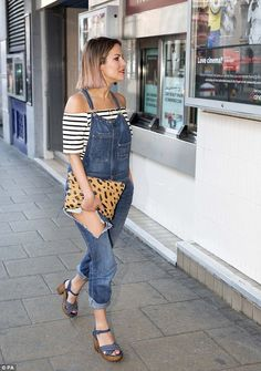 Stunner: She then headed to the Cineworld in London's Haymarket, wearing denim dungarees a...