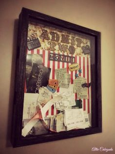 "Pinterest inspiration with my own little twist. ""Admit Two"" ticket box. I've seen similar shadow boxes with tickets but I didn't like the fact that they said admit one. I used cardstock paper for the background (stripped red and white) and popcorn scrapbook paper on top. The letters are bronze 3D letters to add a vintage look.  We placed it right by the TV and it looks fantastic."
