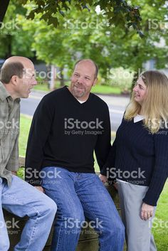 three people in conversation royalty-free stock photo