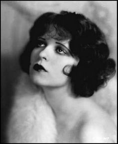 Clara Bow - Make-up in this era was heavy, dark eyes (typically kohl rimmed), full lashes, and rouge (cupids bow was popular to give that plump pouty look), Eyebrows were thin and curved downward toward the temple. Short hairstyles such as the bob cut, Eton Crop/shingle and the Marcel Wave also known as the finger wave came into vogue. Women typically wore their hair short to fit under the cloche hats they wore.