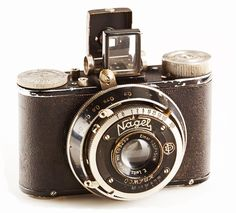 Kodak (Nagel) Pupille   Circa 1932 The Pupille was in the works when Kodak bought his firm.  This camera was marketed under both the Kodak and Nagel badges, as well as branded as the Rolloroy in Britain.   This camera was likely sold in Europe, since it does not have the Kodak logo on the lens front.  The Pupille uses type 127 film.  The two threaded socket to the left of the viewfinder accept a rangefinder.