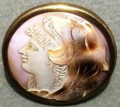 GORGEOUS CARVED MOTHER OF PEARL BUTTON WITH A BRASS RIM - 1 1/8""