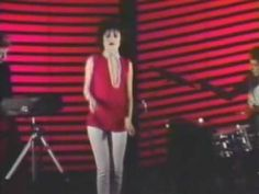 """Siouxsie And The Banshees - Red Light  """"She falls into frame with a professional pout but the polaroids ignite on seeing their subject and the aperture shuts-too much exposure"""""""